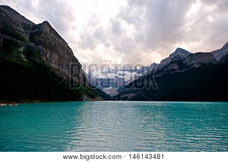 Green alpine lake and storm clouds. Banff National Park. Rocky Mountains. Alberta. Canada.