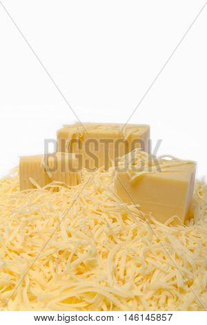 whole and grated cheese on white background