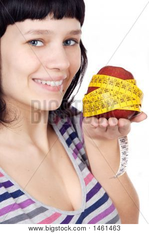 Attractive Girl With Apple And Tape Measure In The Hand