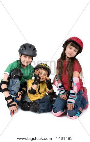 Three Children In Helmets