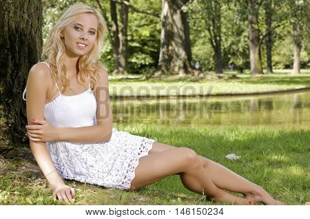 Portrait of a beautiful young adult attractive sexy and sensuality pretty blond woman in the garden