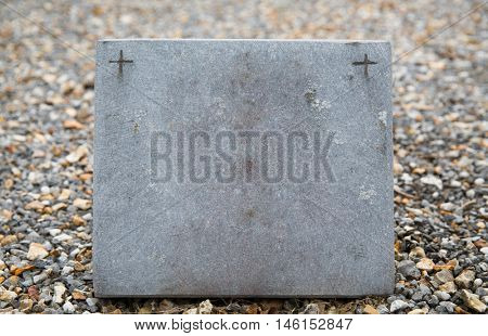 grave and burial concept - old catholic cemetery gravestone