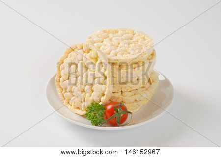 stack of puffed rice bread slices on white plate