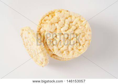 stack of puffed rice bread slices on white background