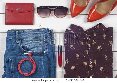 Women clothing set and accessories on light background.Top view different shoes on light background. Copy space for text.