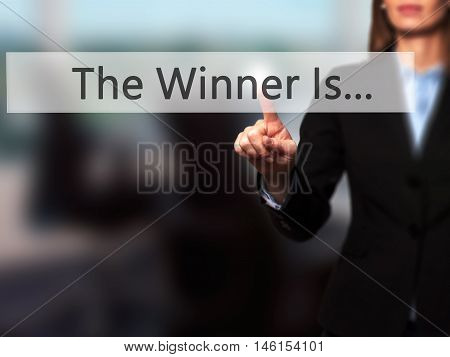 The Winner Is... - Businesswoman Hand Pressing Button On Touch Screen Interface.