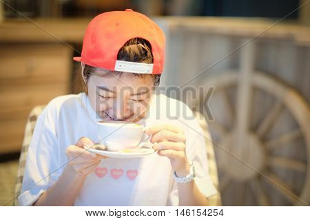 Coffee. Beautiful Girl Drinking Tea Or Coffee In Cafe. Beauty Model Woman With The Cup Of Hot Bevera