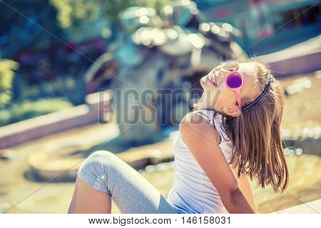 Beautiful young girl teen outdoor. Happy pre-teen girl with braces and glasses. Summer hot day.