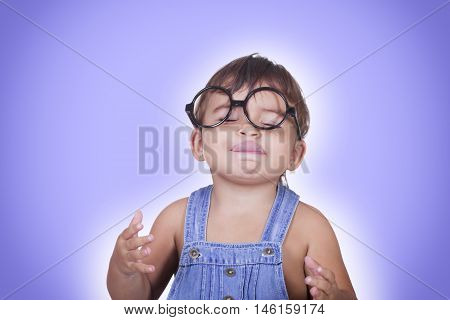 Happy Kid In Glasses Enjoying Something With Eyes Closed