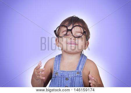 Happy Kid In Glasses Enjoying Something With Eyes Closed
