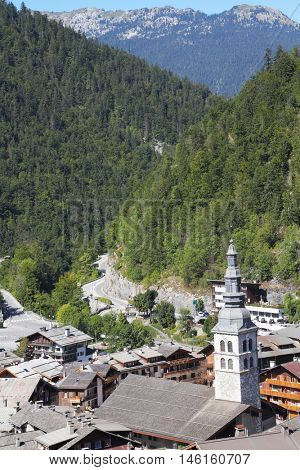 French Alps. Church steeple towers over the small town of Green Mountains