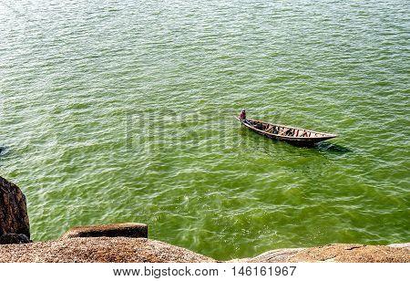 Mwanza,Tanzania,Africa- March 26. 2016: Man paddling on the boat on lake Victoria in Mwanza Tanzania