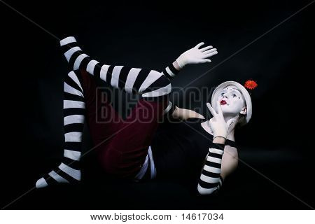 Funny Mime In White Hat  Lying On Floor