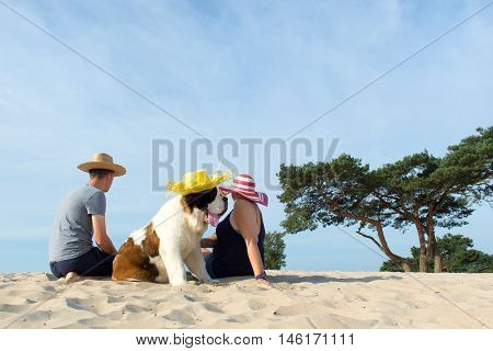 Owners With Their Dog At The Beach