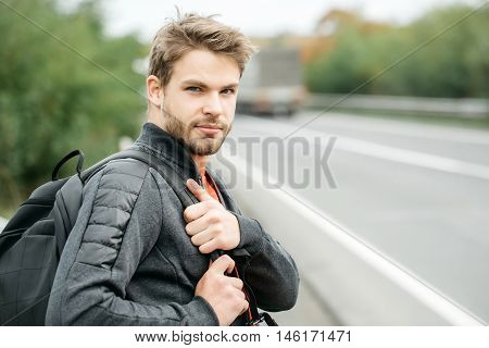Handsome Macho Man With Backpack