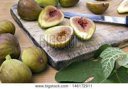 Fresh and healthy organic figs on a wooden board slashed in half
