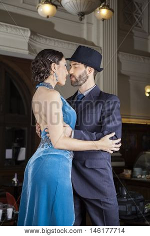Confident Tango Dancers Embracing In Cafe