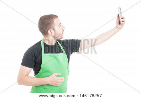 Young Supermarket Employee Taking Selfie