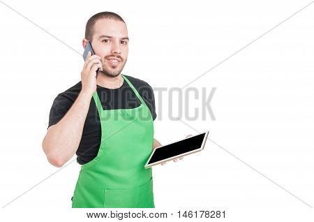 Male Employee Holding Phone And Tablet