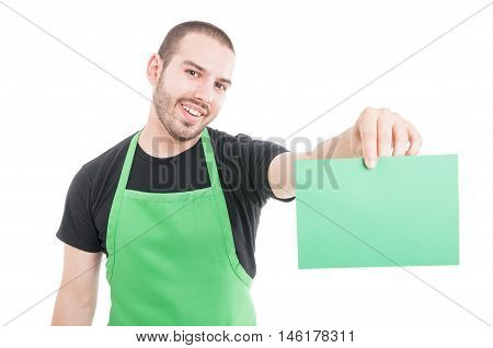 Market Employee Showing Green Cardboard And Smiling