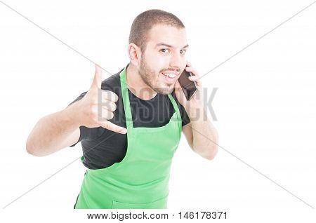 Hypermarket Clerk Making Call Me Gesture At Phone