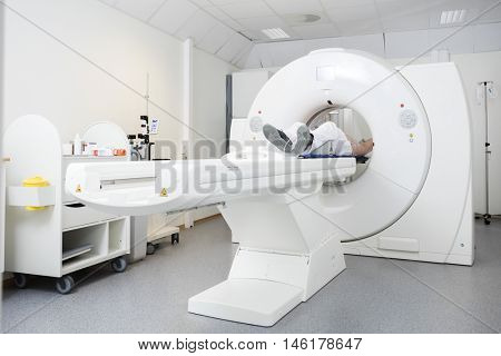 Patient Undergoing CT Scan In Hospital