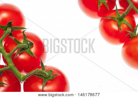 Cherry tomatoes isolated over white background close up