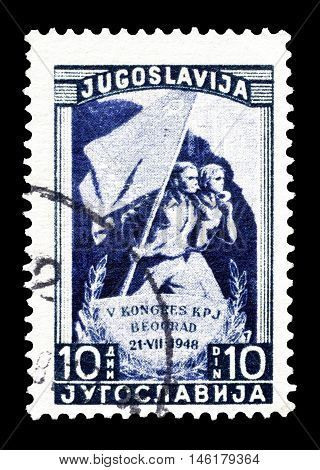 YUGOSLAVIA - CIRCA 1948 : Cancelled postage stamp printed by Yugoslavia, that shows Marchers with party flag.