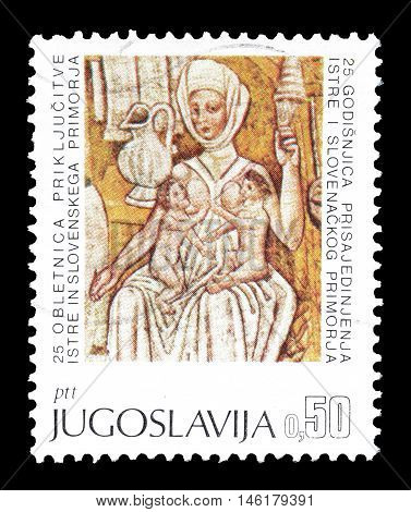 YUGOSLAVIA - CIRCA 1968 : Cancelled postage stamp printed by Yugoslavia, that shows Mother nursing twins fresco.