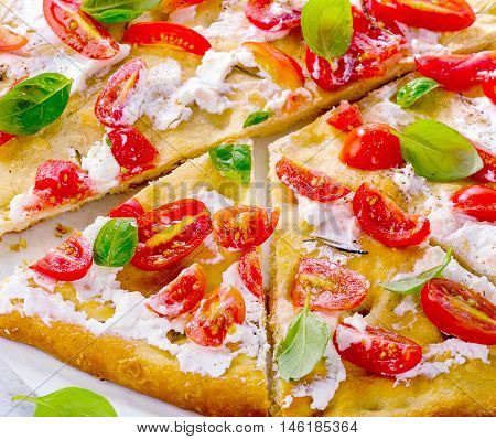 Italian Traditional Focaccia With Tomatoes, Cream Cheese And Basil