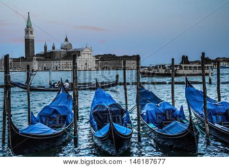 The gondola is a traditional, flat-bottomed Venetian rowing boat, well suited to the conditions of the Venetian lagoon. It is similar to a canoe except it is narrower. The rowing oar, which is not fastened to the hull, is used in a sculling manner, also a