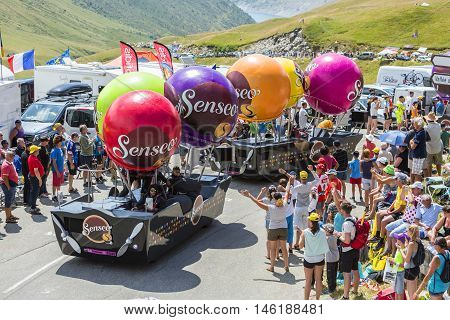 Col du Glandon France - July 23 2015: Senseo caravan during the passing of the Publicity Caravan on Col du Glandon in Alps during the stage 18 of Le Tour de France 2015. Senseo is a registered trademark for a coffee brewing system.