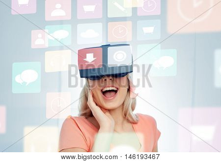 technology, augmented reality, cyberspace, multimedia and people concept - happy amazed young woman with virtual headset or 3d glasses at home looking at menu icons