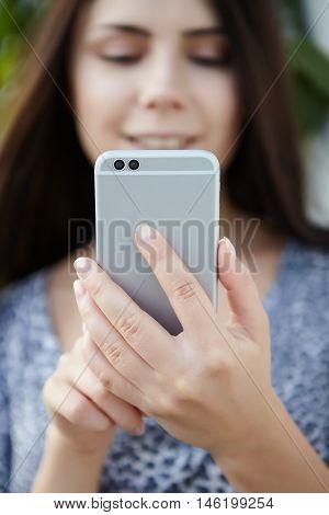 Girl Taking Photo With Modern Dual Camera Smart Phone