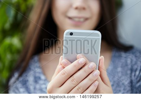 Girl Taking Photo With Big Silver Smart Phone