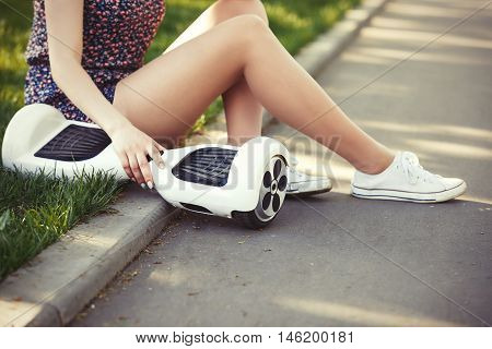Girl With Electric Mini Hover Board Scooter Transport