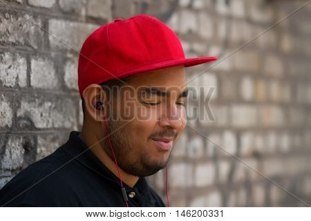 Young Black Boy Listening To Music In Headphones