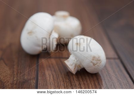 Champignon Mushrooms On Wooden Table