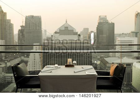 travel, vacation, tourism and business concept - roof top restaurant lounge at hotel in bangkok city