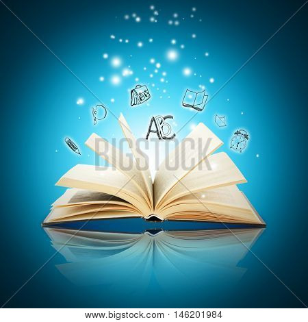 Book with icons on blue background