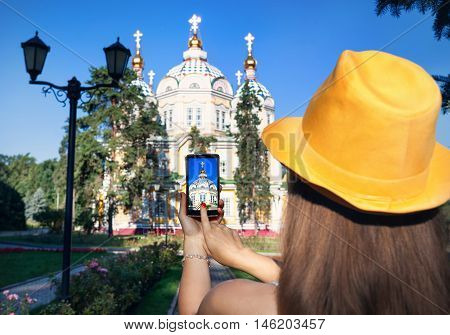 Woman Taking Picture Of Church By Phone