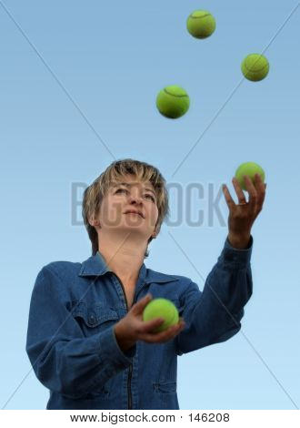 Woman Juggling With Tennis Balls