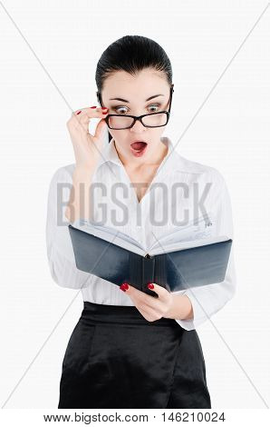 surprised, shocked businesswoman holding glasses and looking for in a notebook even more closely