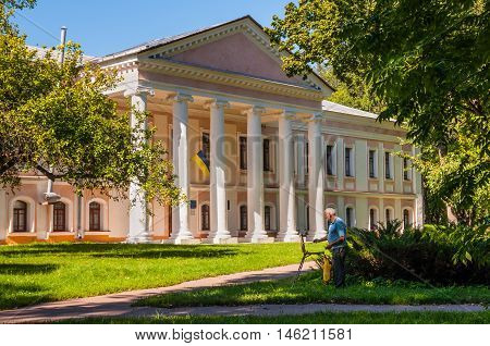 Chernihiv Ukraine - August 28 2016: The artist paints a picture near the Governor's house (1804) in Chernihiv Ancient Ukraine. Chernihiv Ancient is the National Architecture-Historical Sanctuary located in the north-eastern Ukrainian city of Chernihiv.