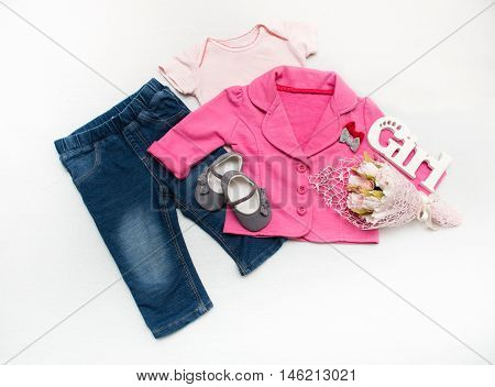 Set Of Baby Girl Clothes On Holiday.