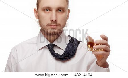 Young man holding glass with alcohol on white background.