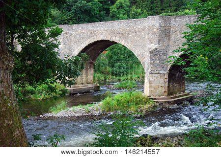 Yair Bridge with river Tweed below in autumn
