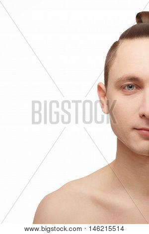 Half face of young man. Half of young man face with a perfectly smooth skin on white background