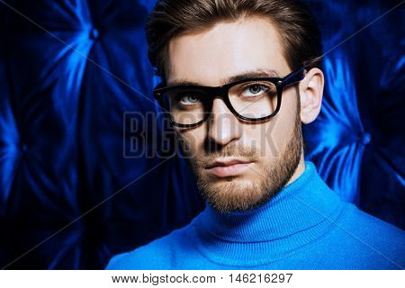 Imposing young man in spectacles. Men's beauty, fashion. Optics style.