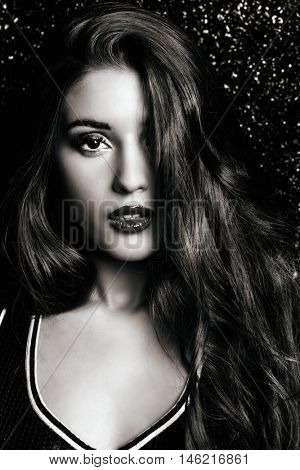 Black-and-white portrait of a a beautiful woman with sensual lips. Eyelash extensions, false eyelashes.